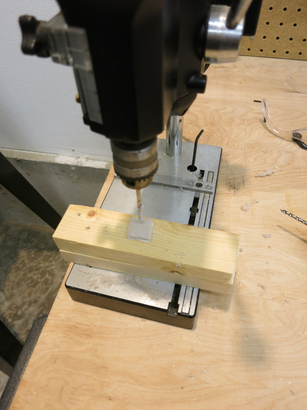 Drilling a hole in the felt