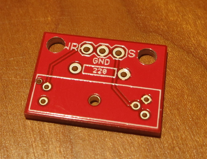 Sparkfun board with holes drilled into it