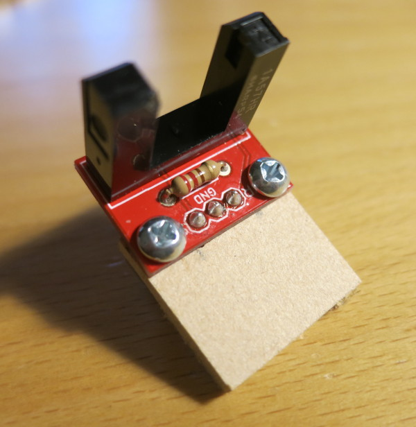 Photo interrupter mounted to a scrap board