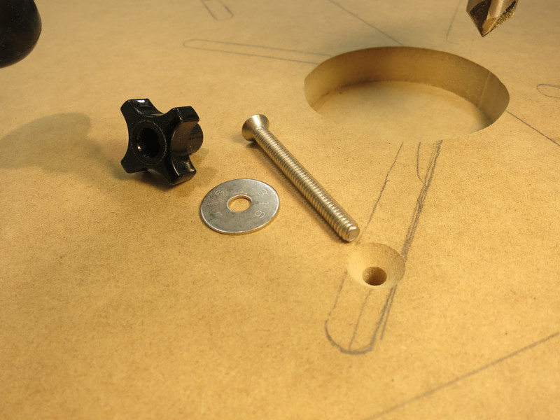 The parts for bolting the table down