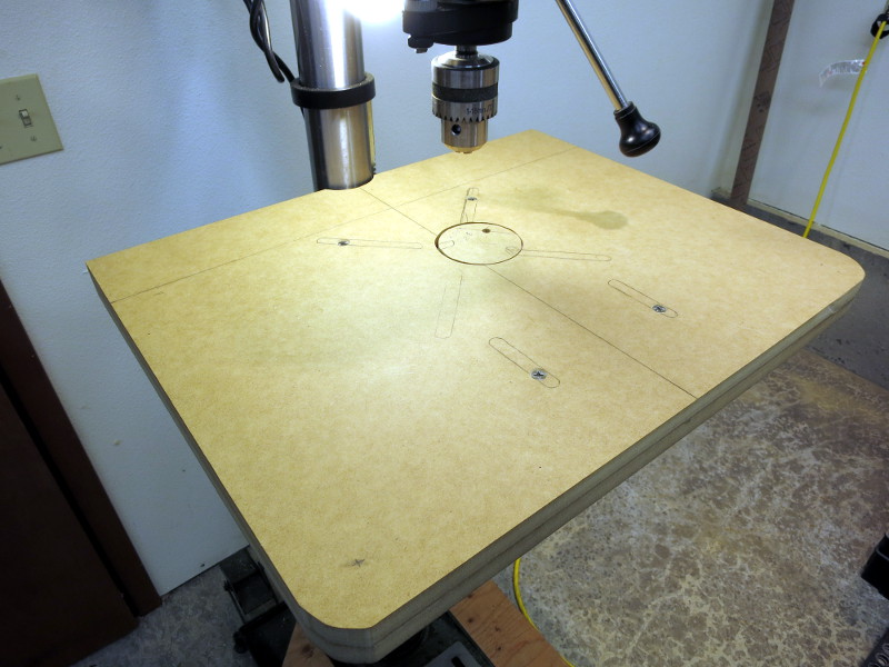 The table bolted to the drill press