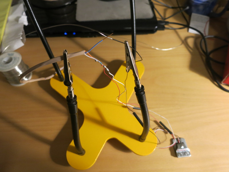 Preparing to solder (note the heat shrink tubing is on the wire)