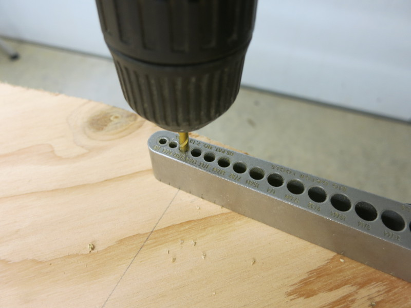 Drill one hole near the edge of the top plywood circle
