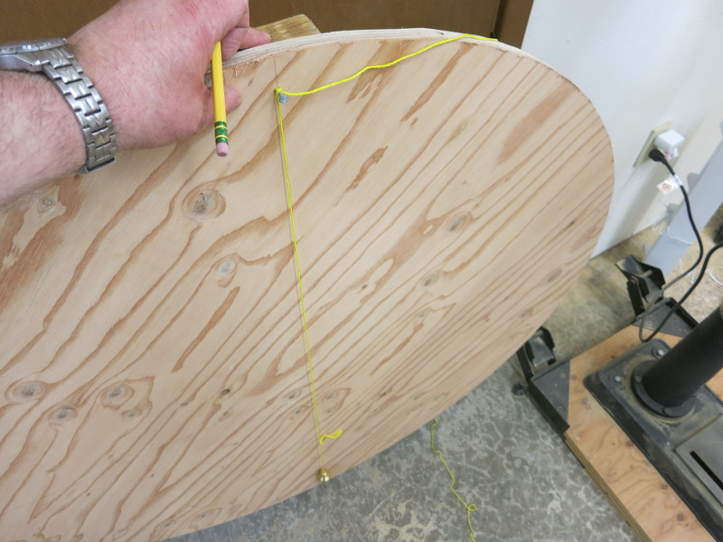Hanging a weight from the nail