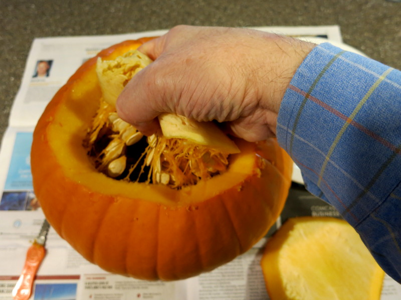 Plunge your hand into the pumpkin
