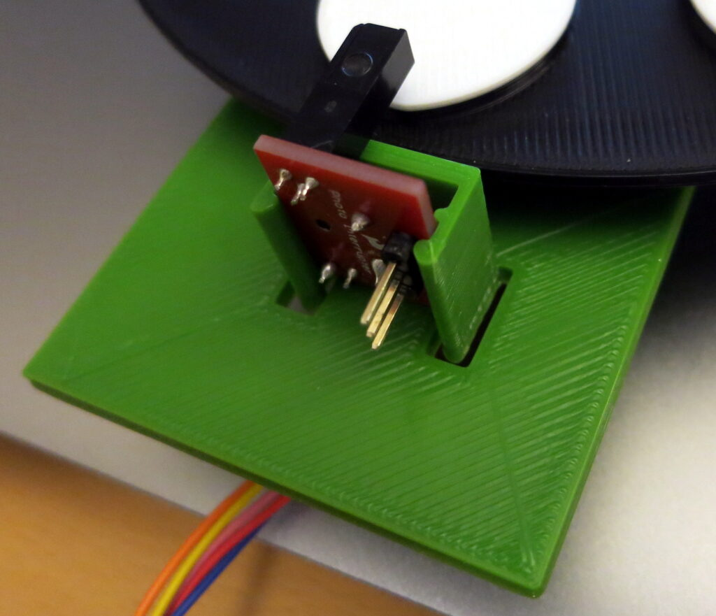 printed clip, holding the photo interrupter