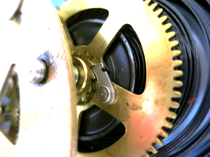 The 'click' that holds the spring's ratchet in place