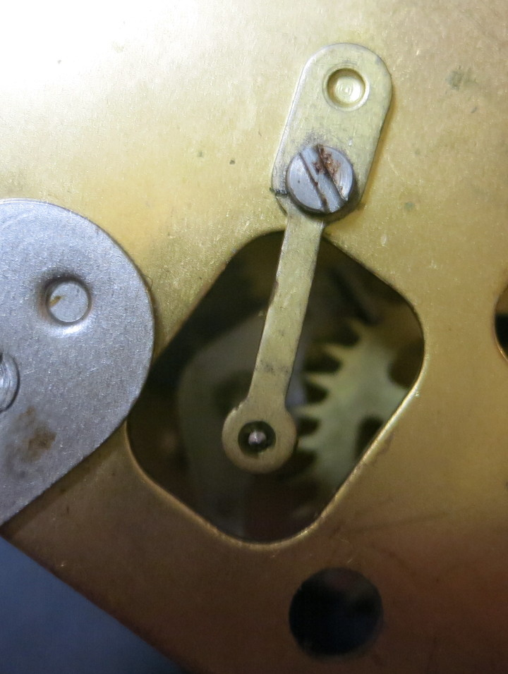 The screwed-in plate that holds the escapement in place