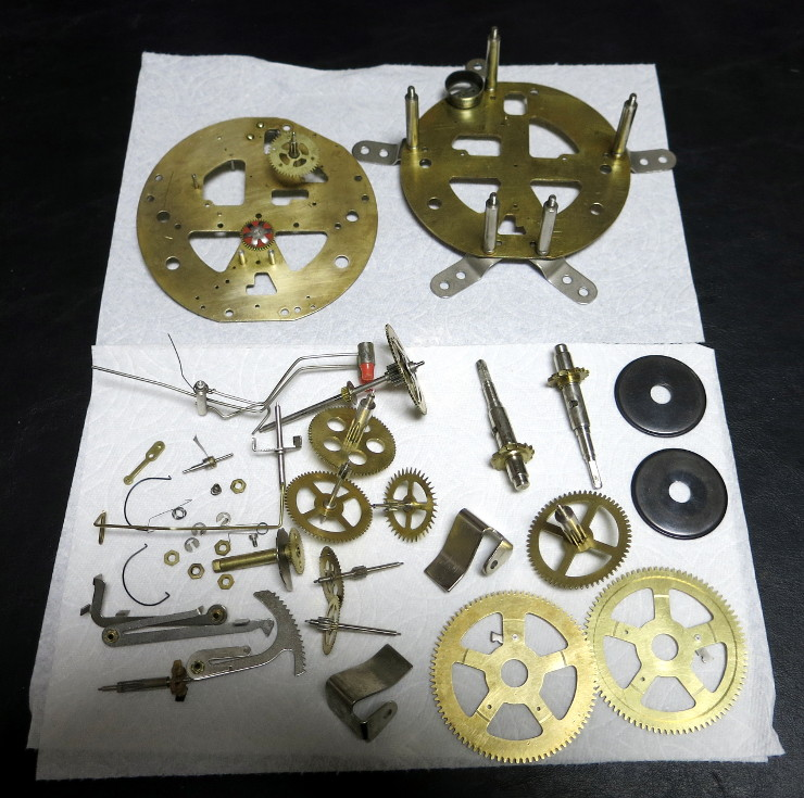 The clock parts after cleaning by hand