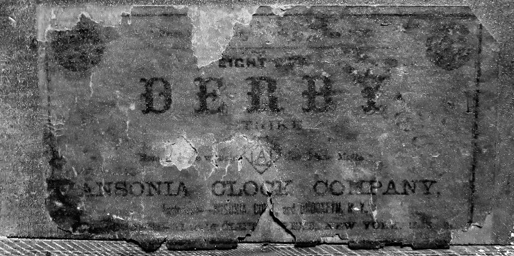 """Enhanced photo of the label reads """"DERBY"""" , """"Eight [day] Strike"""", """"Ansonia Clock Company"""""""