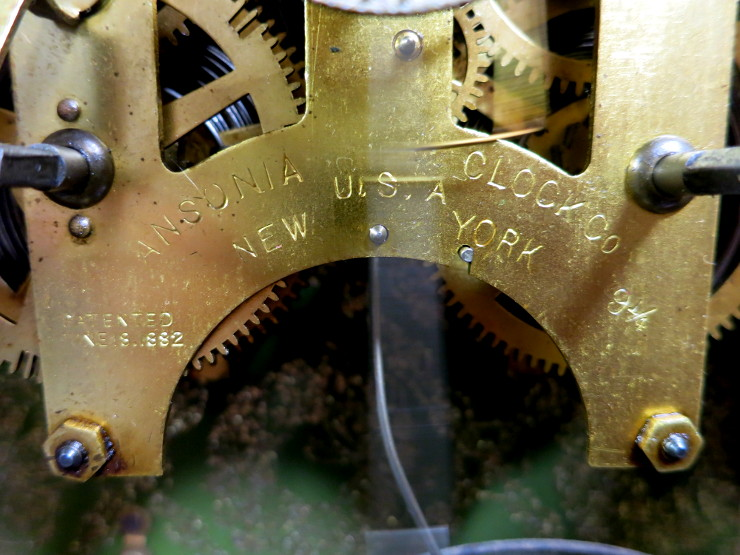 """The movement, stamped """"Ansonia Clock Co."""""""