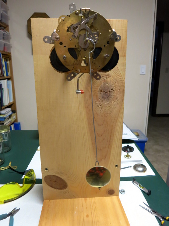 The clock running with the over-long pendulum