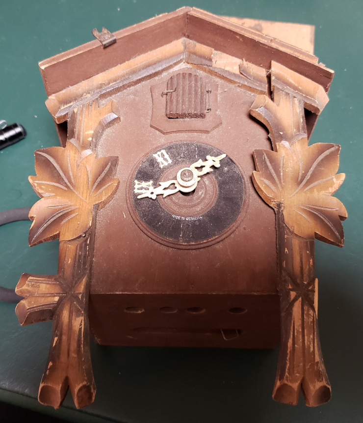 The clock as it came. Likely from falling off the wall