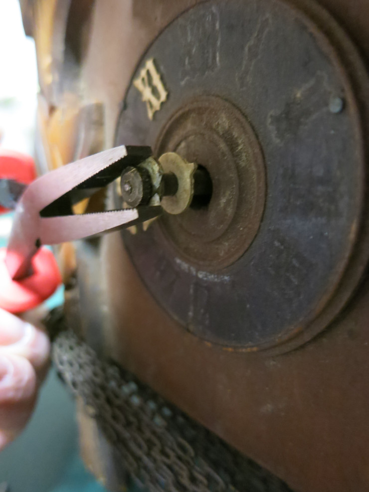 Removing the too-tight hand nut with pliers