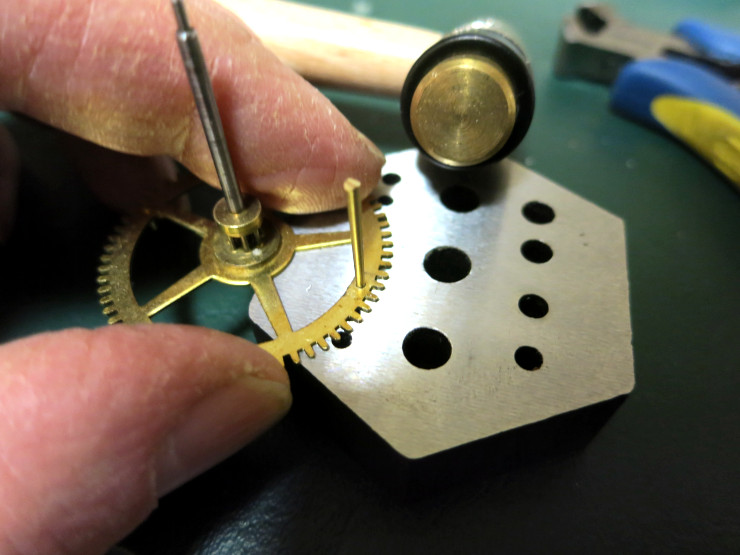 tapping a new tapered pin into place
