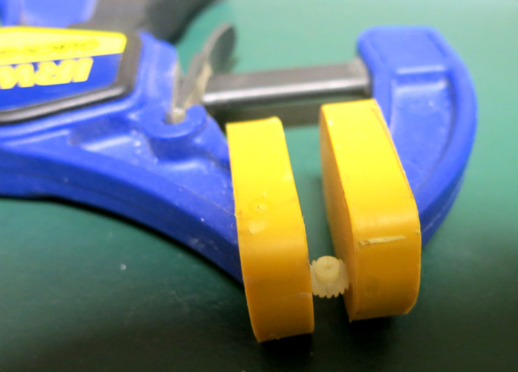 clamping the glued gear to hold the crack closed