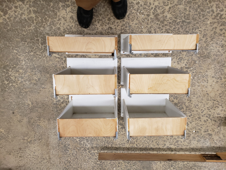 Drawers laid out on the garage floor, to scale