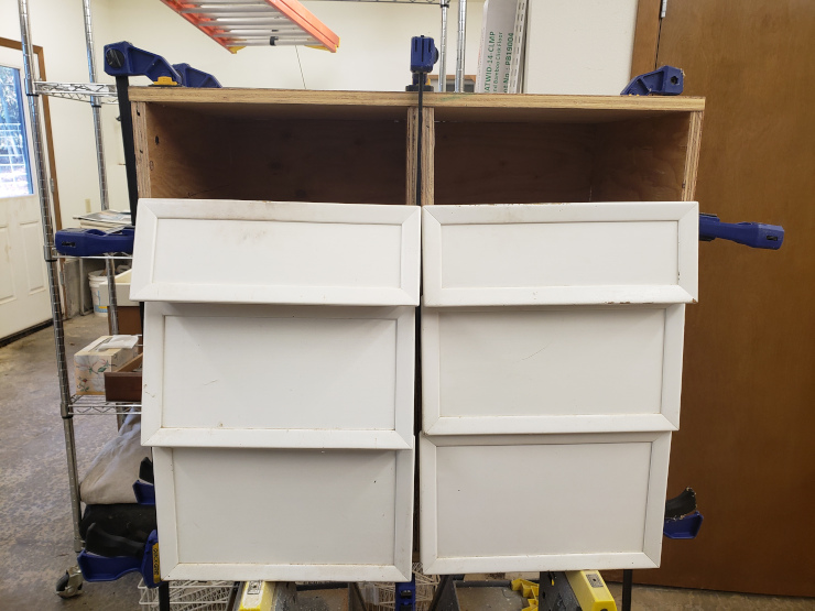 Test fitting the drawers into the screwed-together cabinet