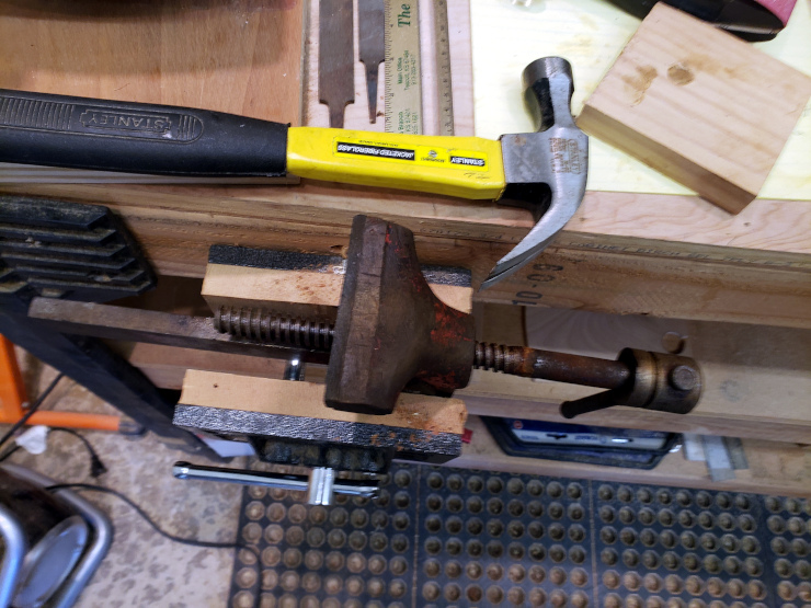 Whacking on the left end of the screw, I've freed the (not shown) thick washer that held the screw in place